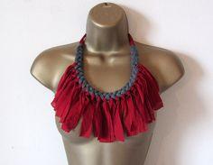 Plaited fabric necklace with fringes, gray and red. Soft and comfortable to wear, fastened with ties.