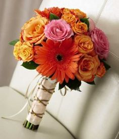 """This beautiful, hand-tied """"Captivating Colour Bouquet"""" featuring orange roses, hot pink roses, and orange Gerbera daisies would be perfect for a fall wedding. #wedding #flowers"""