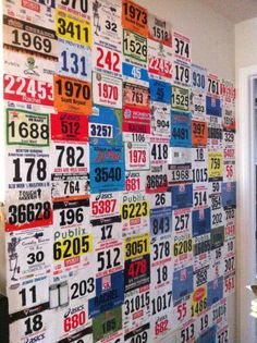 Running Race Bib Wall paper - in our weight room !!! Great idea !!