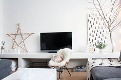 eclectic living room by Louise de Miranda. A sheet of wrapping paper is a decoration (I could frame some different ones, or just wrap foam core). Also like the heart lights