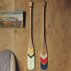 artisan green canoe paddle    CB2 I thought these were cool. If you didn't want to do the boat over your bed. These would look great!