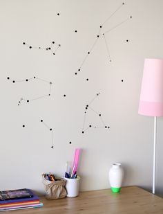 Snag some stickers and create some star constellations for a no-holes art piece you can make any size for any room, as seen on A Subtle Revelry. - DIY Wall Art: 10 Fun & Affordable Ideas to Add Personality to a Rental