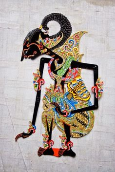 """Wayang is an ancient Javanese word meaning """"shadow"""" or """"ghost."""" It is also the name for the traditional sacred dramas of Java and Bali. There are seven main forms of wayang, but wayang kulit, or shadow-puppet theater, Living Puppets, Wallpaper Hp, Wallpaper Keren, Cultures Du Monde, Shadow Theatre, Indonesian Art, Batik Art, Dutch East Indies, Javanese"""