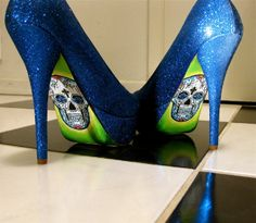 "These gorgeous heels are to die for.  Hand painted a skull on the back make these heels super scary but sexy! The heels are approximately 5"" and are electric blue with glitter."