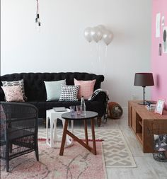 By Simone Borcherding stylist   writer   spacemaker. Lounge with black chesterfield sofa, pink wall, balloons, geometric rug, Skinny laMinx fabric and silver accents.