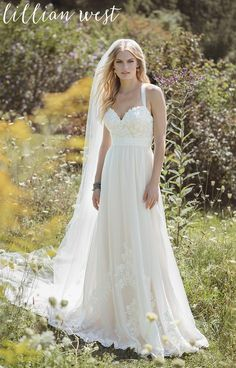 A gown that embodies a dream romance. A sweetheart neckline, soft organza straps and Venice lace with an A-line organza skirt. Hand-placed Venice lace appliques adorn the skirt to the finished hem lace for the perfect boho-chic look.