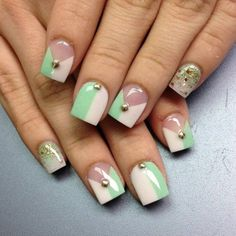 A really creative and cute ensemble for square shaped nails. This French manicure includes a nude, white and sea green ensemble. The nails are coated with clear white polish as base coating. Atop the clear coating are two horizontal strokes of white and sea green polish alongside each other. Additional gold beads are added for accents as well as a few glitters.