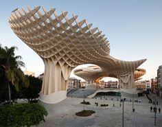 Metropol Parasol in Seville, the world's largest wooden structure; a combination of urban space and functional spaces that include an archaeological museum and restaurants.