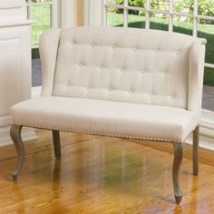 "$350 Elise Fabric Settee Material: Linen Color: Off- white Studded accents Button-tufted design Crafted with strong, solid hardwood frame Fully assembled Seat Height: 19.7 in Settee Dimensions: 44""W x 26""D x 36""H Seat Dimensions: 44""W x 24.8""D Weight: 42 lbs"