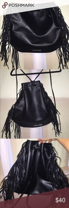 VS Leather purse Super cute leather drawstring purse/backpack. From Victoria's Secret. Cute leather fringe surrounded the bag. Unfortunately the paper tag ripped off but this is brand new never been used. Victoria's Secret Bags Shoulder Bags