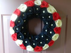 Flag Wreath - Summer Patriotic Decoration - Red White and Blue Felt Flower Wreath - 14 inch. $45.00, via Etsy.