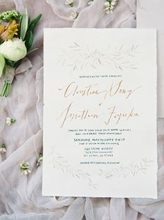 This elegant wedding invitation feels naturalistic but it also features calligraphy with lots of personality.