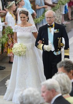 Sweden's King Carl Gustaf walks his daughter, Princess Madeleine, down the aisle on her wedding day