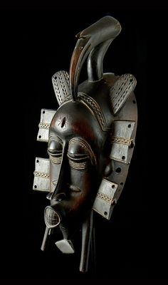 Africa | Senufo Kpeliye'e Mask | Wood; dark brown patina