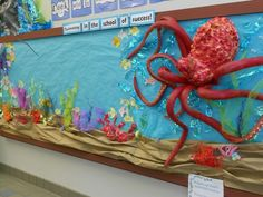 Under the sea bulletin board made with pool noodles and spray foam. Suction cups cut from dollar store bath mat.