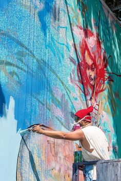 Photographer Martha Cooper documents artist David Choe painting the Bowery Wall in New York City