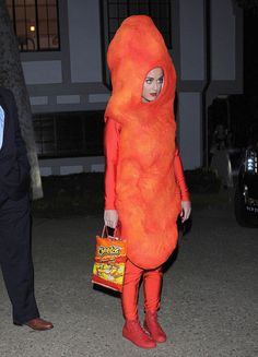 Katy Perry as a flaming hot Cheeto: | See What Your Favorite Celebrities Are Dressing Up As This Halloween