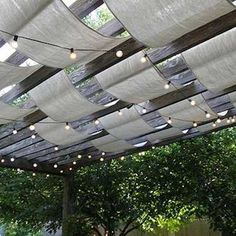The wooden pergola is a good solution to add beauty to your garden. If you are not ready to spend thousands of dollars for building a cozy pergola then you may devise new strategies of trying out something different so that you can re Pergola Canopy, Deck With Pergola, Wooden Pergola, Covered Pergola, Backyard Pergola, Patio Roof, Porch Awning, Pergola Carport, Cheap Pergola