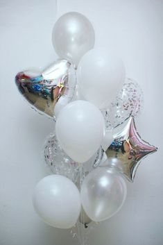 Something like this with big mylars in colors and colorful polka dot balloons filled with confetti