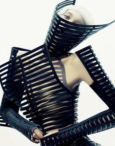 Inna Pilipenko in a striped armor-like dress from Gareth Pugh S/S 2012 photographed by Hyuna Shin for Culture Magazine April 2012