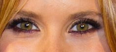 1.  Line eyes with eggplant or aubergine.  2.  Line inner rims with black.  3.  Cover lids in shimmery gold