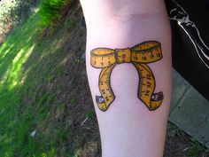 measuring tape tattoo