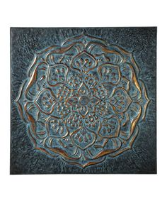Take a look at this Midwest-CBK Dark Blue Embossed Floral Wall Décor today!