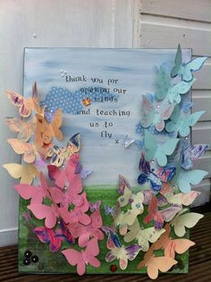 Beautiful end of term/year teacher gift. Each child decorated and wrote their name on a paper butterfly. I painted and decoupaged a plain A3 size canvas and then glued the butterflies on with some other embellishments. The teacher loved it and whispered that it was the best present she had ever received! So I can truly recommend for any crafty person to go and make one of these! :-)