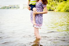 Mom with her son, standing in water Photo by Winter Cherry Photography