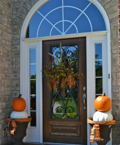 I like the scroll door.  This is a cute front porch, clean and simple.