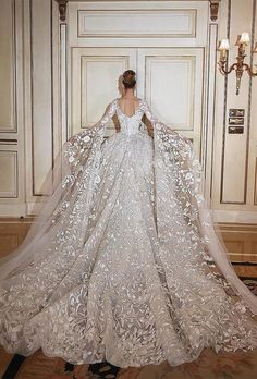 71 Elegant White Wedding Dresses The wedding dress is filled with delicately feminine details. Which is irresistibly romantic bridal collection features elegant wedding dresses. Click the picture to see more beautiful Wedding Dresses 2018, Princess Wedding Dresses, White Wedding Dresses, Bridal Dresses, Dress Wedding, Lace Dresses, Wedding Dress Cathedral Train, Fantasy Wedding Dresses, Ugly Dresses