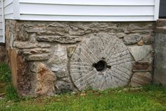 Millstone used as part of a church foundation in Appalachia
