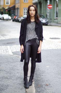 Long black coat / cardigan, black leather leggings, black boots, grey t-shirt
