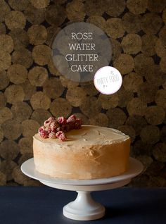 Rose water glitter-cake  If rose water isn't your thing it's no problem at all, just swap it out for another flavoring of your choice. Also, are the glitter raspberries not super awesome?!?! You should steal this idea and put it on other things. They look so cool!
