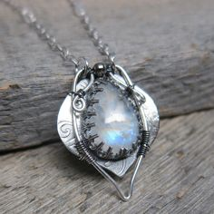 Water Sprite Necklace ... Handcrafted Recycled Fine Silver Bezel with Wire Wrapping and Rainbow Moonstone. $132.00, via Etsy.
