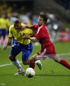 Tugay Kerimoglu of Turkey tries to tackle Ronaldo of Brazil during the FIFA World Cup Finals 2002 Semi-Final match played at the Saitama Stadium, in Saitama-Ken, Japan on June 26, 2002. Brazil won the match 1-0. DIGITAL