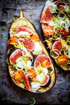 Grilled and filled eggplant with fresh cheese, spring onion, cherry tomatoes and figs.