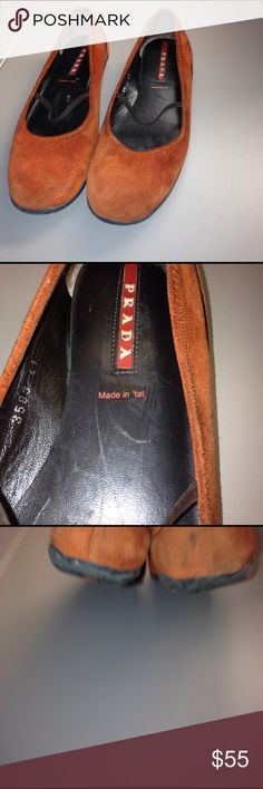 Prada ballet shoes Burnt orange suede flats. Nylon elastic strap. Rubber signature soles. Needs cleaning mostly on heels. Minor wear on soles. Comfy & stylish Prada Shoes Flats & Loafers
