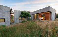 Six modular, concrete boxes comprise a five-bedroom home on Martha's Vineyard, in Chilmark, Massachusetts. Designed with the sloping seaside site in mind, it was built to guard against potential erosion: Connected by interstitial wood paneling, each of the six units can be moved in just a week and fully installed in a few months.