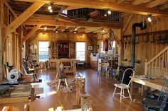 A couple weeks ago I discovered a picture of Greg Pennington's  chairmaking shop. The structure is a timberframed paradise of hand too...