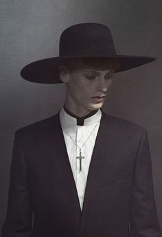 I love the idea of taking something typically girly and giving it a masculine edge, with a wide rim hat and clerical collar with the added extra of alternated colours, a modern vicar
