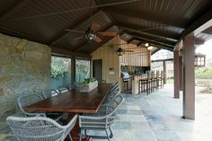The pool cabana features a built-in barbecue and bar.