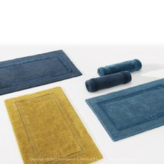 Another favorite of DeWoolfson customers who desire classic simple styling is the Reversible Bath Rug made by Abyss and Habidecor. This rug has a plush center on one side and a nubby texture on the other.