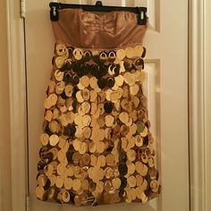 Express gold dress size 0 Glamourous look. Worn twice. Strapless. Slight fringes on top part of dress (3rd pic). Couple gold pieces slightly bent (2nd pic). Express Dresses Midi