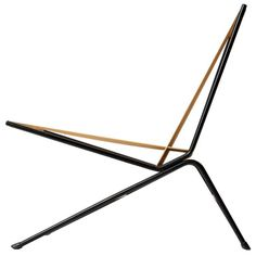 lounge chair by Allan Gould USA 1950's An indoor/outdoor lounge chair with a black wrought iron frame and the original woven cord seat and back.