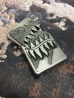 Shop the official Zippo store! This dragon design features an attached emblem and a surprise - open the jagged teeth to reveal a fiery cloud of flame. Zippo Collection, Cool Lighters, Take My Money, Light My Fire, Dragon Design, Zippo Lighter, Edc Gear, Everyday Carry, Cool Stuff