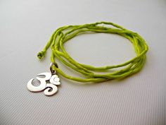 Silk wrap bracelet with sterling silver Om charm