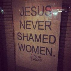 "[photo: sign in window says ""Jesus never shamed women.""]"