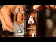 """""""lost point of origin""""; automaton pendant by Kim Nogueira; silver, copper, bronze, mica, pearl, vitreous enamel, paper, thread; 2014"""