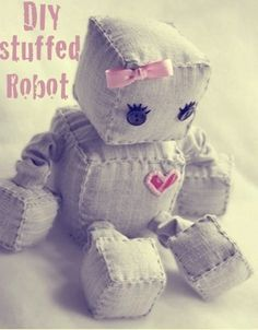 DIY: Stuffed Robot Tutorial . . . can do different colors and fabric- want it grey with a boy accessory. I have the stuffing & instructions seem great so I will give this a try!- making it for him for christmas